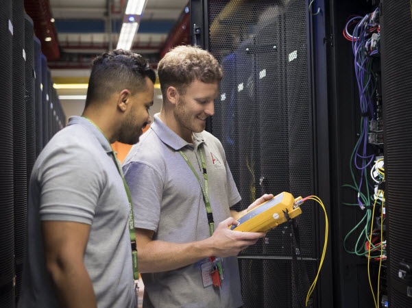 Two men checking the network connectivity