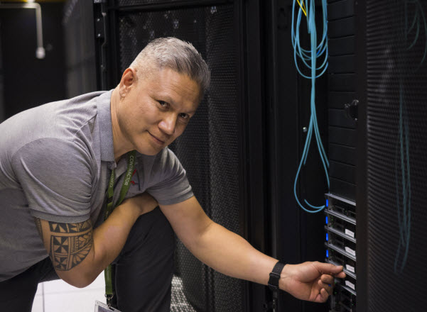 Man checking the connections on the server