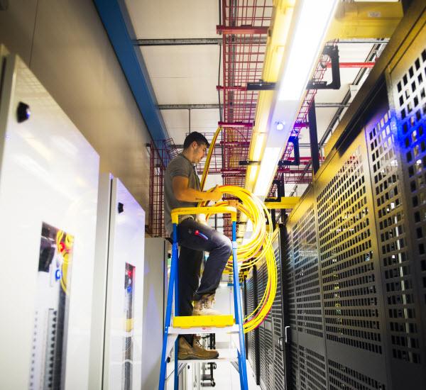 Man installing fibre optic cable