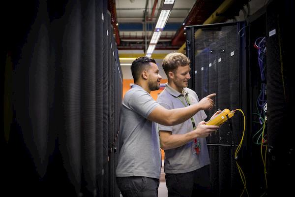 Men checking the SD-WAN connection
