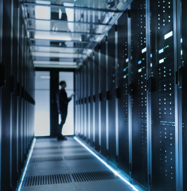 Man checking a data centre inside a room