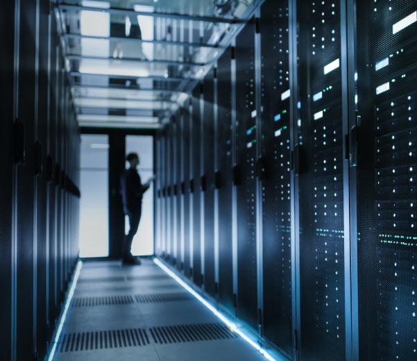 Man inside a dark server room
