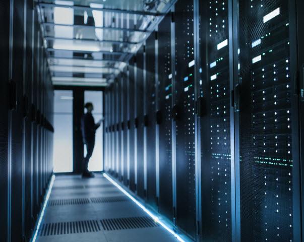 Man checking a data centre inside a room
