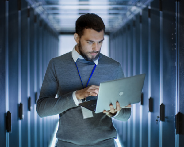 Man using his laptop in data centre